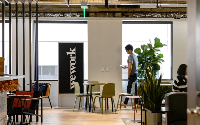 WeWork Reports Narrower Losses As Pitch To Lure In Investors